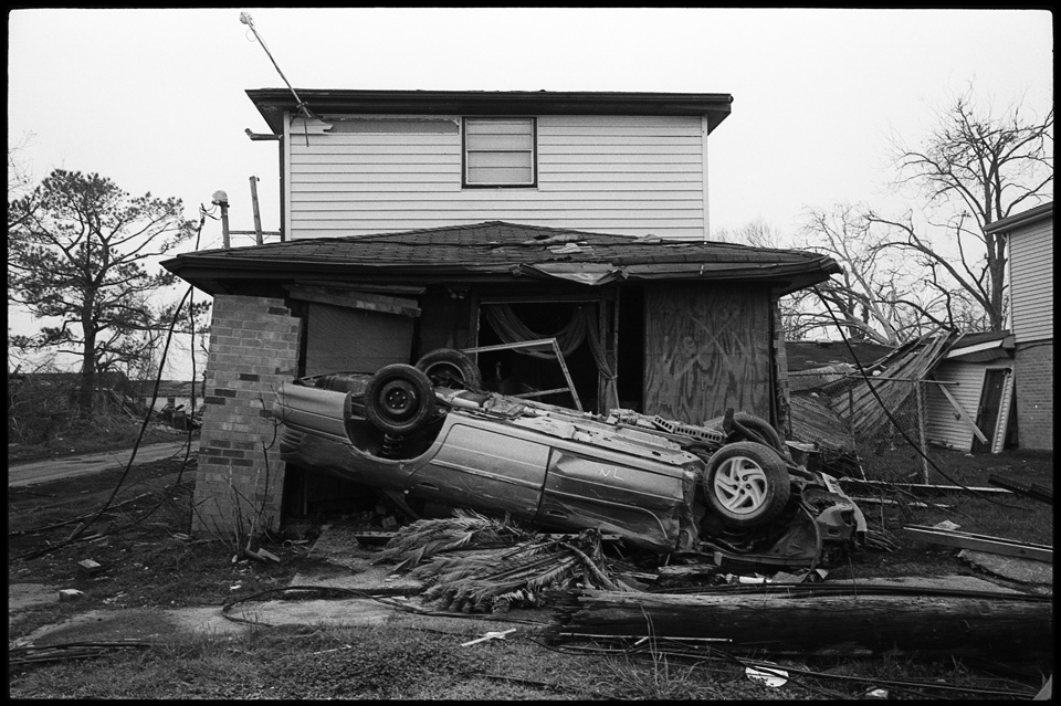 lower 9th ward after hurricane katrina - car on a house