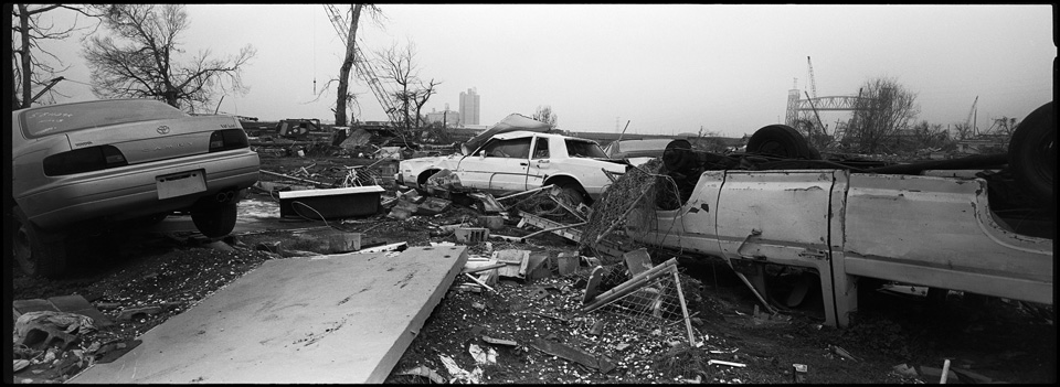 lower 9th ward after hurricane katrina - panoramic of destroyed cars