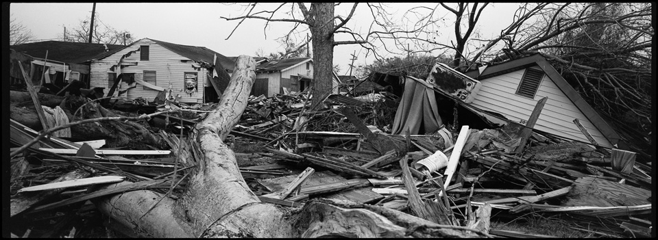 lower 9th ward after hurricane katrina - panoramic of tree and destroyed houses