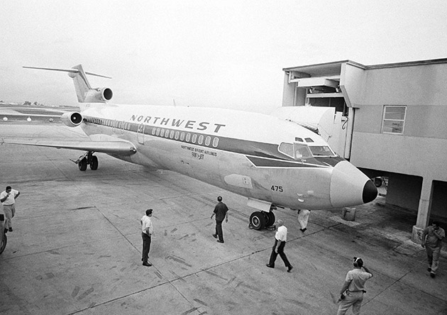 The Northwest Orient Airlines plane that was hijacked to Cuba last night with 87 passengers and 7 crewmen, is docked at the Miami International Airport, July 2, 1968 when it arrived from Cuba with only the crewmen aboard.