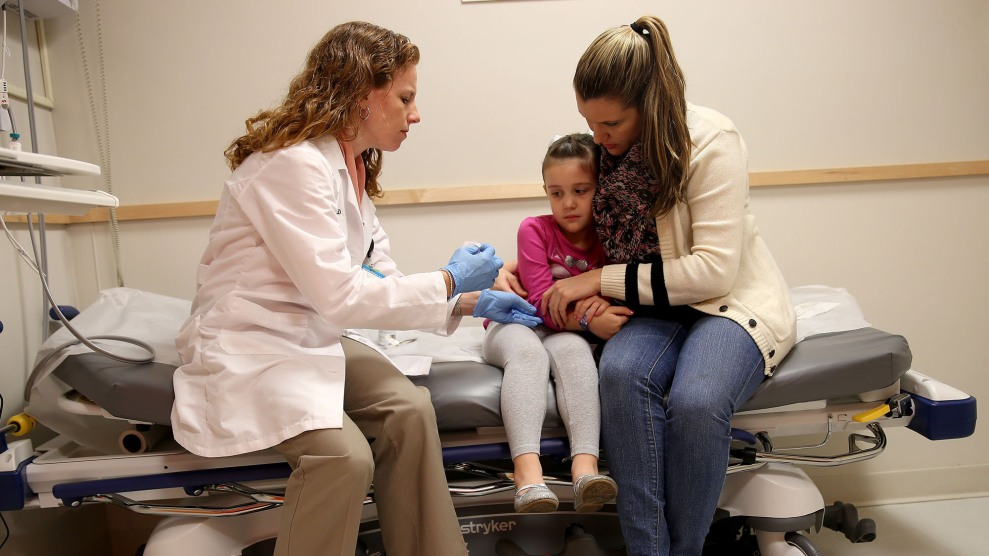 Pediatrician Dr. Amanda Porro prepares to administer a measles vaccination to Sophie Barquin, 4, as her mother holds her during a visit to the Miami Children's Hospital on January 28, 2015.