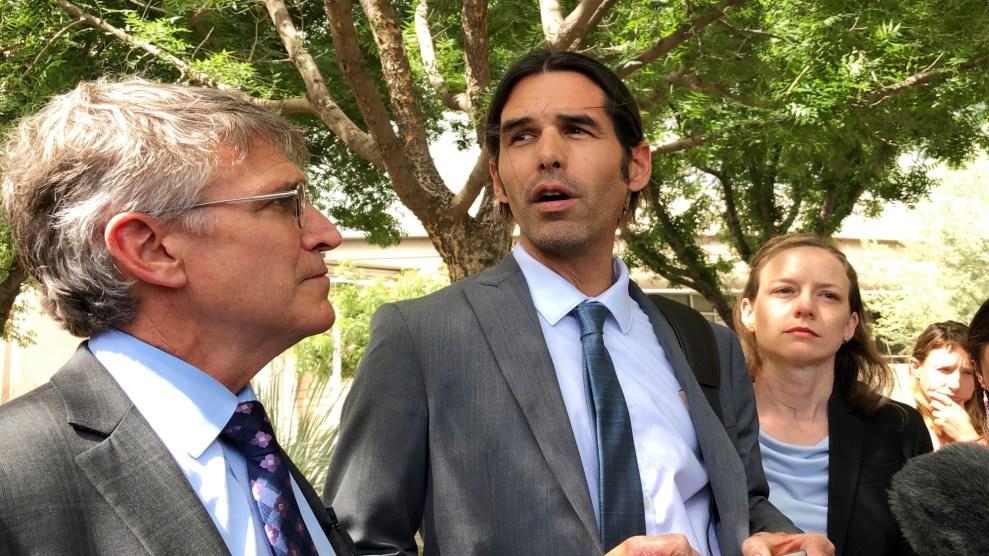 Scott Warren (center) speaks after his high-profile court case ends in a mistrial.