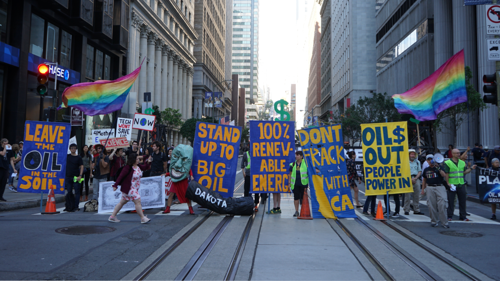 Climate activists block off a street in San Francisco's Financial District.