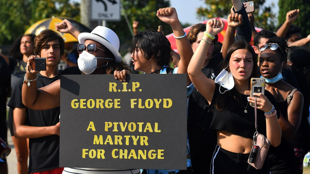 Mourners watch the funeral procession of George Floyd in Houston on June 9.