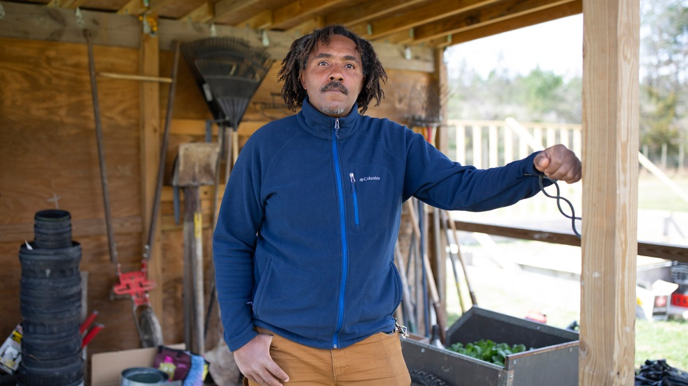 Tahz Walker stands on land that he and others own communally as part of Earthseed Land Collective in Durham, North Carolina on March 14, 2021. Walker and his partner Cristina Rivera-Chapman run Tierra Negra Farm which provides produce for farm shares as well as fresh vegetables to communities in downtown Durham.