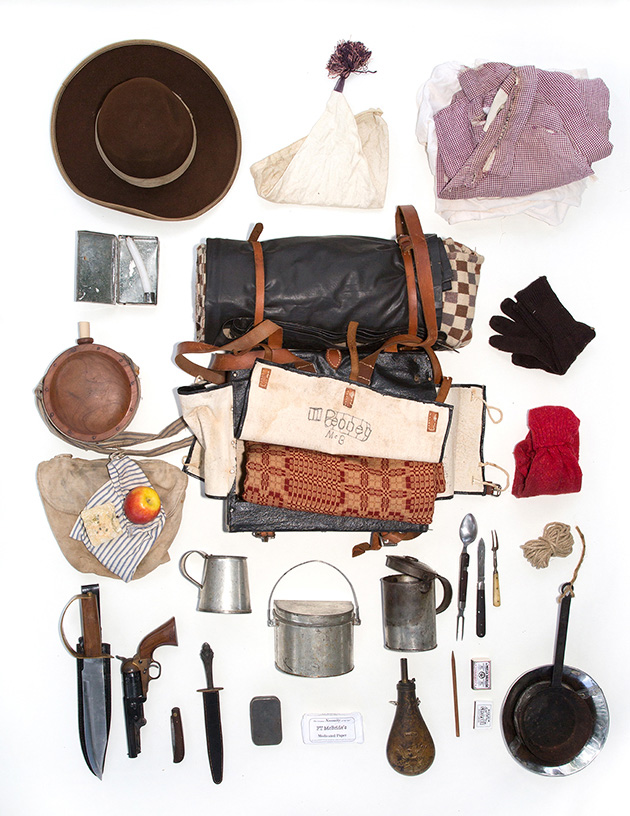 Phil is a Civil War Reenactor.  His bag contains the supplies a civilian in 1964 would carry to bug out.  It includes hardtack and an apple for food, cooking gear, wool blankets, and lye soap.