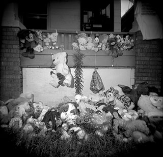 A makeshift memorial on Aiyana's porch.