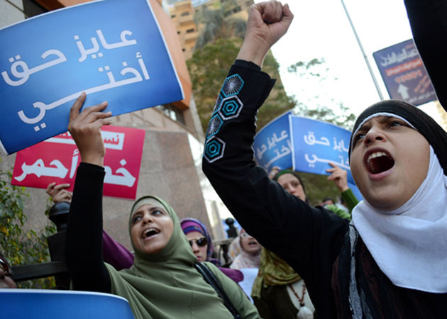 "Egyptian women protest the ruling military council's ""virginity tests"" in December 2011.  Ayman Mose/ZUMA Press"