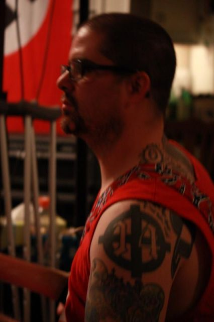 Wade Michael Page, with a white-power tattoo visible on his shoulder. Myspace