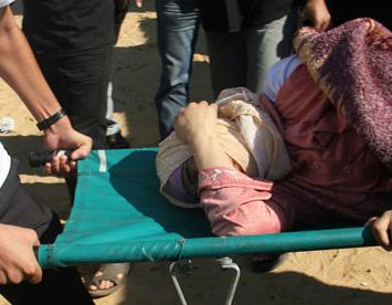 Nov. 15, 2012 - Khan Younis, Gaza Strip, Palestinian Territory - Palestinian medics treat a wounded woman at a hospital after an Israeli air strike in Khan Younis in the southern Gaza Strip  (Credit Image: © Eyad Al Baba/APA Images/ZUMAPRESS.com)